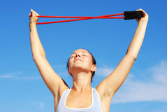 Morning charging. Young attractive woman doing morning sports exercises Stock Images