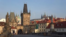 Morning on Charles bridge. View of the old town bridge tower. Prague, Czech Republic stock footage