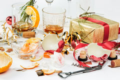 The morning after christmas day, table with alcohol and leftovers Royalty Free Stock Photos