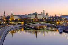 Morning city landscape with view on Moscow Kremlin and reflections in water of river stock image