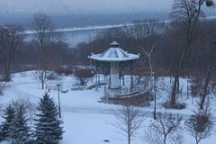 Morning in city. Pavilion in the Park VÑ–chnoj Slavi. Buildings are hiding in the fog on the left bank of the Dnipro. Winter landscape. Kyiv. Ukraine stock images