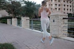 Young woman is having a morning city run stock photos