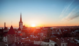 Morning cityscape with rising sun in old Tallinn Royalty Free Stock Images