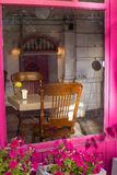 Morning in the closed caffe. With the pink window stock photos
