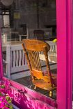 Morning in the closed caffe. With the pink window stock photo