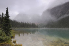 Morning cloud over Cavell Lake in Canadian Rockies Stock Photos