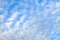 Morning Clouds. Scattered clouds in a blue morning sky Stock Photo