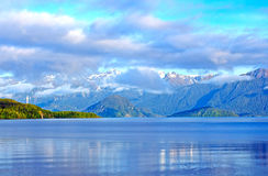 Morning and clouds and mountains in the Fiordlands Royalty Free Stock Photos