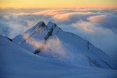 Morning clouds in mountains Stock Photos