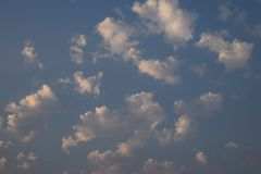 Morning Clouds from my front porch. Clouds float above my house at daybreak on a summer morning royalty free stock photography