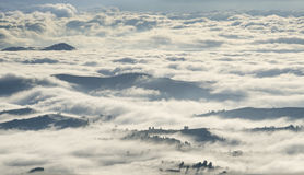 Morning clouds over mountains, forests and villages Royalty Free Stock Images