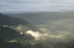 Morning clouds over villages and forests Stock Photo