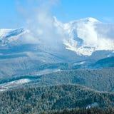 Morning cloudy winter mountain landscape. Stock Photos