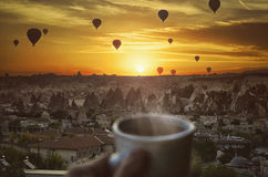 Morning coffe , Hot air balloons  and amazing beautiful sunrise. Over Goreme in Cappadocia, Anatolia, Turkey Stock Image