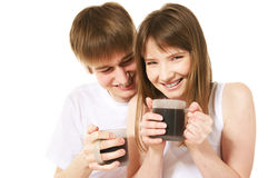 Morning coffee. Happy young couple having a coffee Royalty Free Stock Image