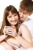 Morning coffee. Happy young couple having a coffee royalty free stock photos