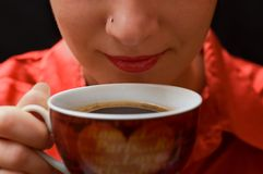 Morning coffee. Girl with nose piercing drinks hot coffee Royalty Free Stock Images