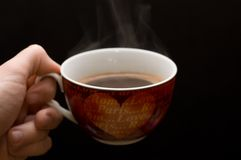 Morning coffee. Picture of a cup filled with hot drink Stock Image