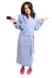 Morning coffee. Woman in a robe and slippers holding her coffee on a white background Stock Photo