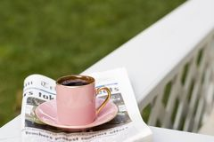 Morning coffee. Cup of coffee and today's newspaper is a good start for a day royalty free stock image