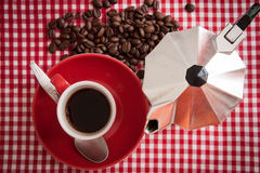 Morning coffee. Morning fragrance: a cup fresh coffee with coffee beans and coffee machine Stock Images