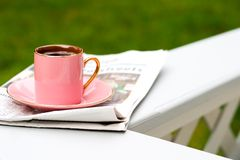 Morning coffee. Cup of coffee and today's newspaper is a good start for a day Stock Photos