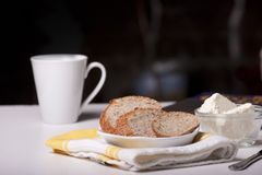 Morning coffee. With a light breakfast of whole wheat bread Royalty Free Stock Images