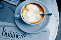 Morning coffee. And business section of paper royalty free stock image