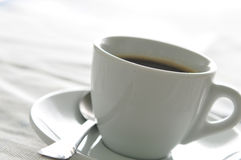 Morning coffee. The cup of coffee isolated over white background Royalty Free Stock Photography