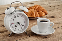 Morning coffee with alarm clock Royalty Free Stock Photos