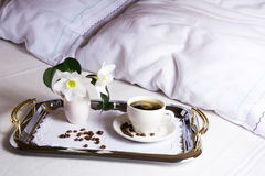 Morning coffee in bed on elegant silver serving tray. Cup of coffee on exquisite embroidered napkin as best hotel service concept Stock Photos