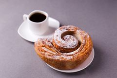 Morning coffee and biscuit - high-calorie breakfast, unhealthy food, modern bad habits, caffeine and fast carbohydrates. royalty free stock photos