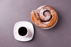 Morning coffee and biscuit - high-calorie breakfast, unhealthy food, modern bad habits, caffeine and fast carbohydrates. royalty free stock photo