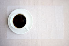 Morning Coffee. Black coffee, white cup, coffee cub on fabric background top view Stock Photos