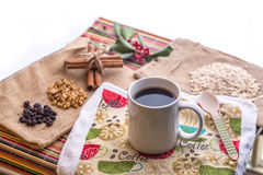 Morning coffee with breakfast ingredients. Coffee with raisin, walnut, and cinnamon stick on table towel Stock Photography