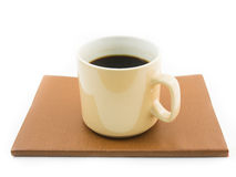 Morning coffee on brown notebook. Isolated on white stock images
