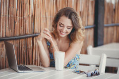 Morning coffee a business woman in a summer cafe Stock Photos