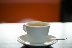 Morning coffee in a cafe. Morning coffee on the table in a cafe Royalty Free Stock Photography