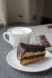 Morning coffee with cake and newspaper. At home royalty free stock image