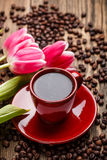 Morning coffee cup. On tray with yellow tulips royalty free stock photos