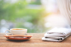 Morning coffee, Cup of coffee with newspapers, near the window.b Stock Images