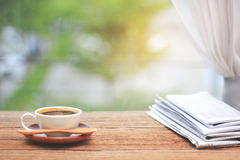 Morning coffee, Cup of coffee with newspapers, near the window.b Royalty Free Stock Photo