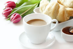 Morning Coffee Cup Croissants and Flowers stock photo