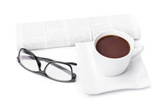 Morning coffee. Cup of coffee with a newspaper and glasses isolated on white background Stock Photos