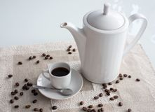 Morning coffee. Coffee cup and coffee pot on the table Stock Photography