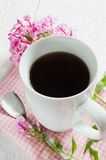 Morning coffee or cup of tea with pink flowers. Stock Photo