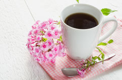 Morning coffee or cup of tea with pink flowers. Royalty Free Stock Image