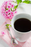 Morning coffee or cup of tea with pink flowers. Royalty Free Stock Images