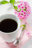 Morning coffee or cup of tea with pink flowers. Royalty Free Stock Photo