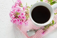 Morning coffee or cup of tea with pink flowers. Stock Images